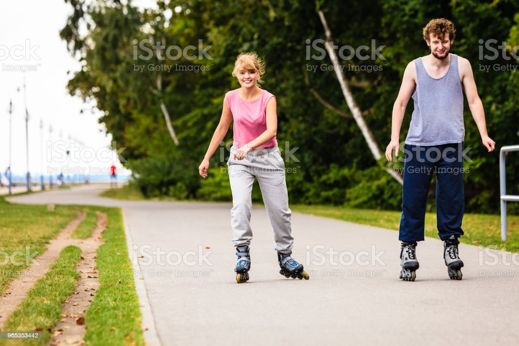 Young people casually rollblading together. zbiór zdjęć royalty-free