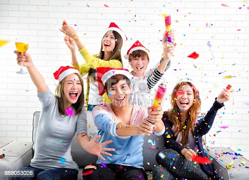 istock Young people celebrating Christmas at home 888053026