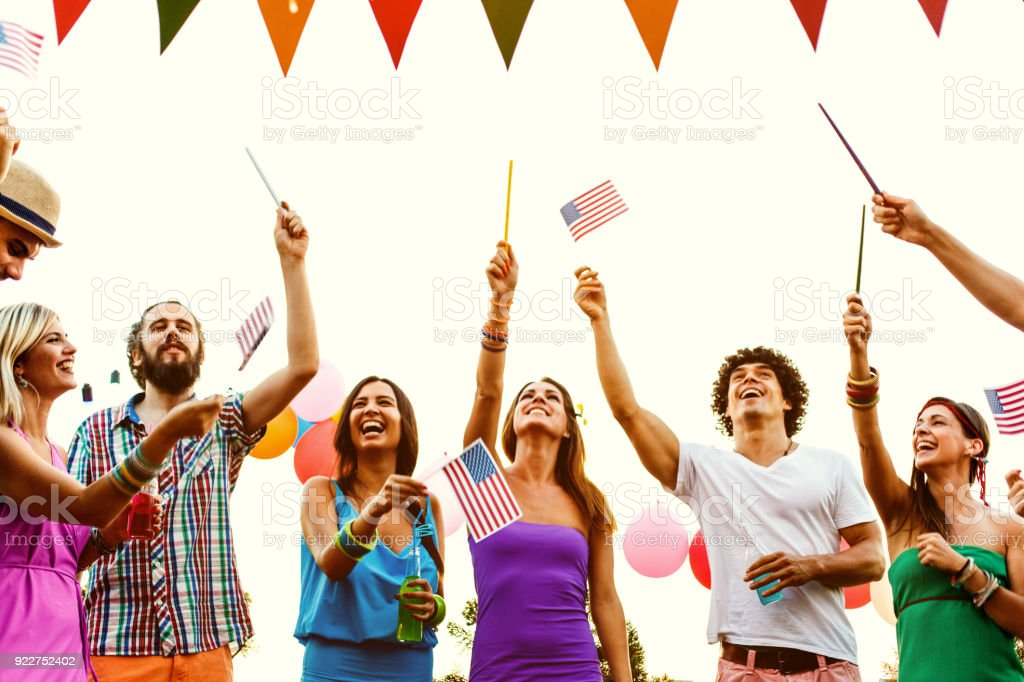 Young people celebrating Independence day stock photo