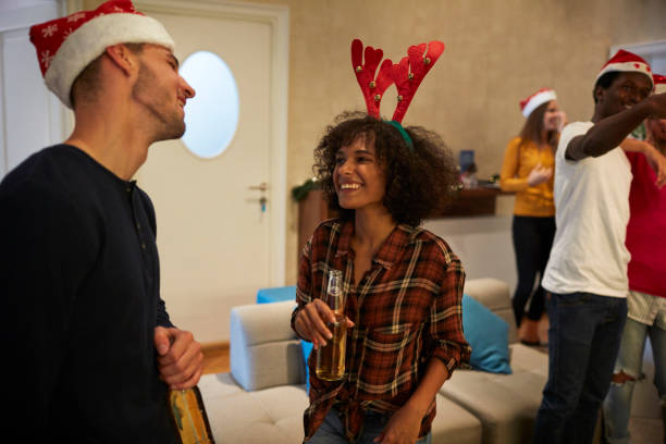 Young People Celebrating New Year in A Hostel stock photo