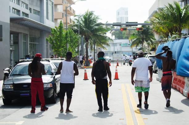 young people celebrating urban beach week miami - memorial day weekend стоковые фото и изображения