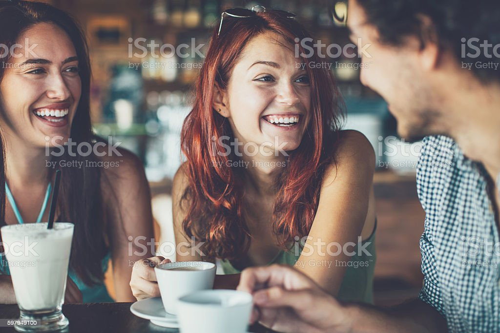 Young people chatting in cafe stock photo