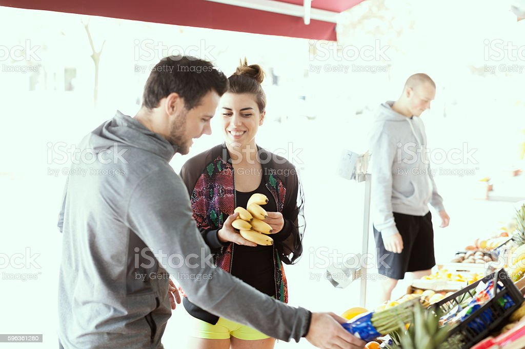 Young People Choosing Healthy Food at Market royalty-free stock photo