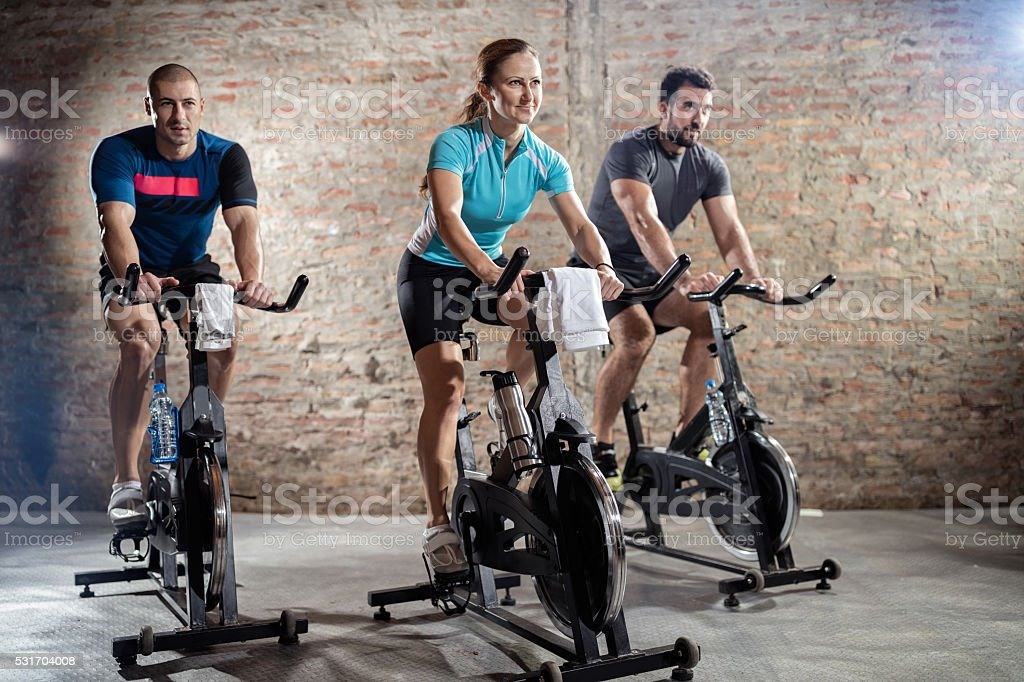 Young people cycling workout stock photo