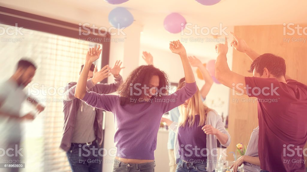 Young people dancing at a party stock photo