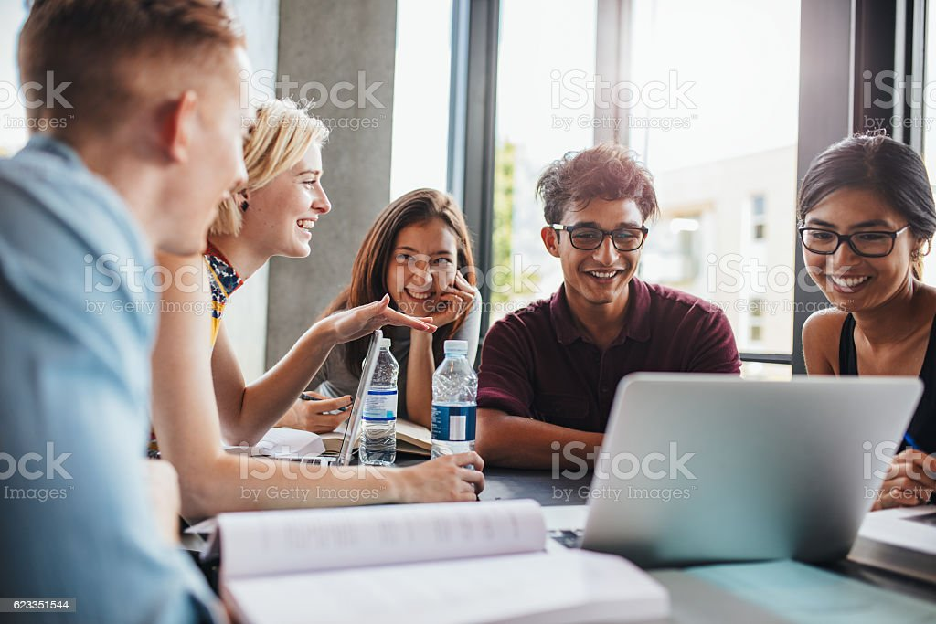 Young people doing group study in library stock photo