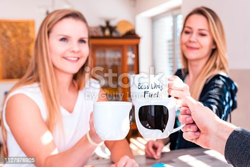 Young caucasian people drinking coffee or tea at home.