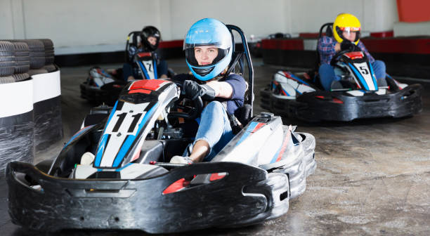 Young people driving sport cars for karting stock photo