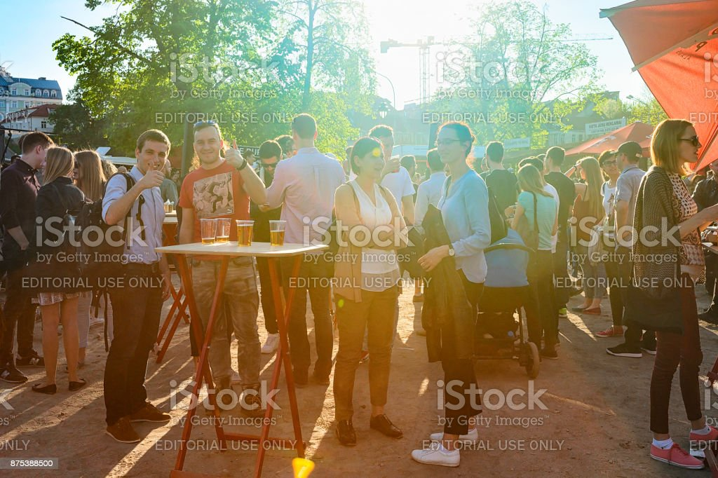 Young people eating and drinking Open Kitchen food festival Vilnius stock photo