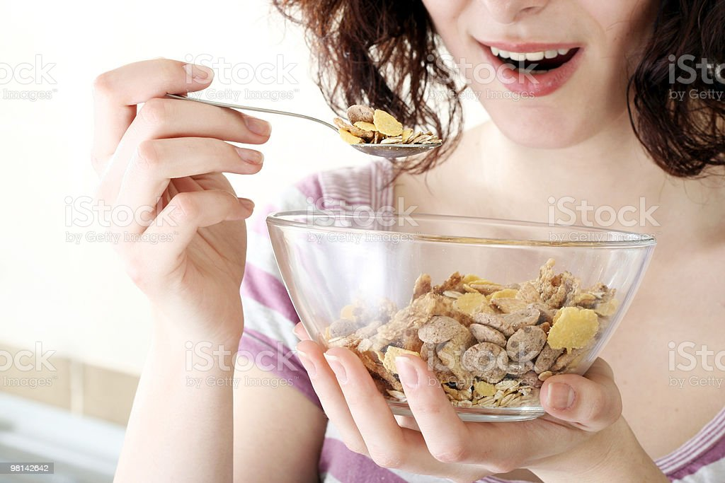 Young people eating milk with cereals royalty-free stock photo