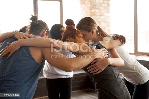 istock Young people embracing in circle standing together, group unity concept 922482666