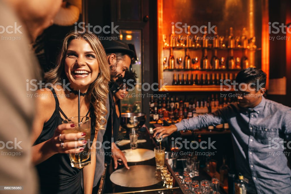 Young people enjoying a night at club royalty-free stock photo