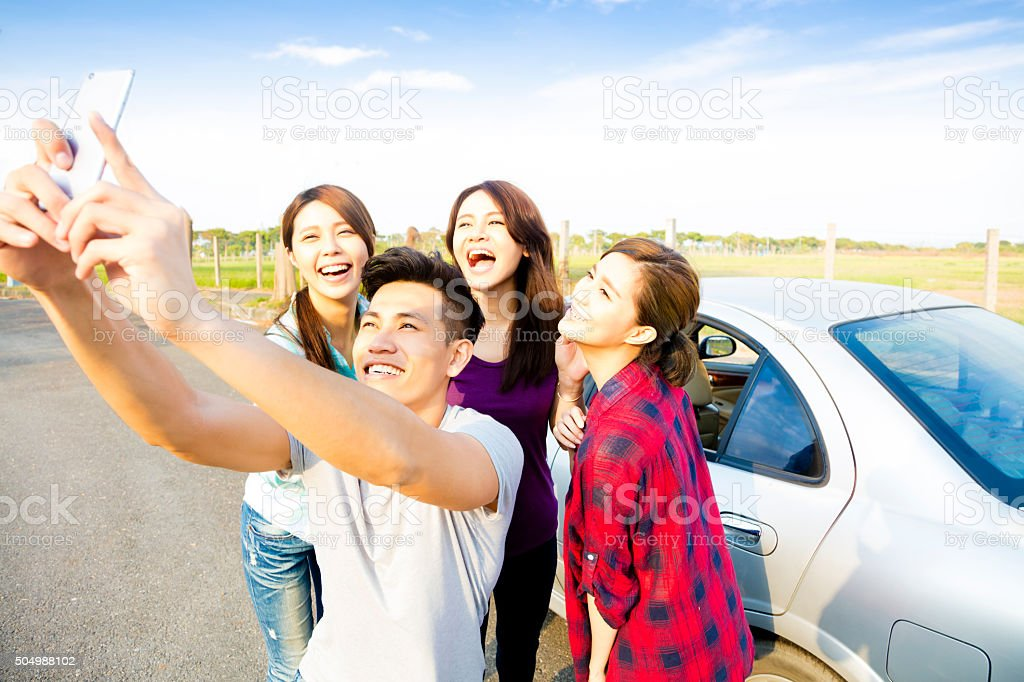 young  people enjoying road trip  and making selfie stock photo