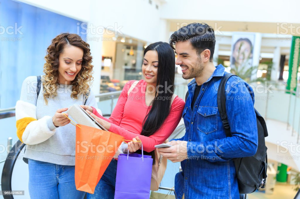 Young people enjoying shopping royalty-free stock photo
