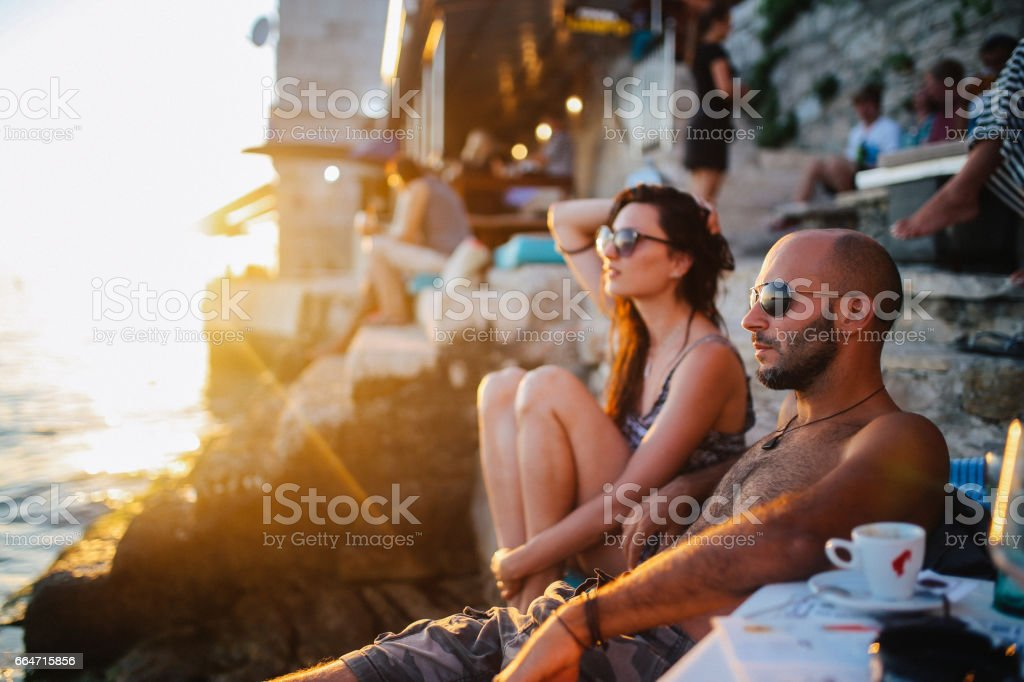 Young people enjoying the summertime by the sea stock photo