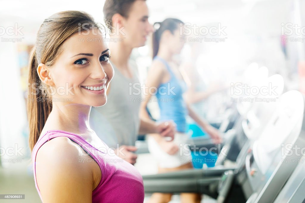 Young people exercising in gym. royalty-free stock photo