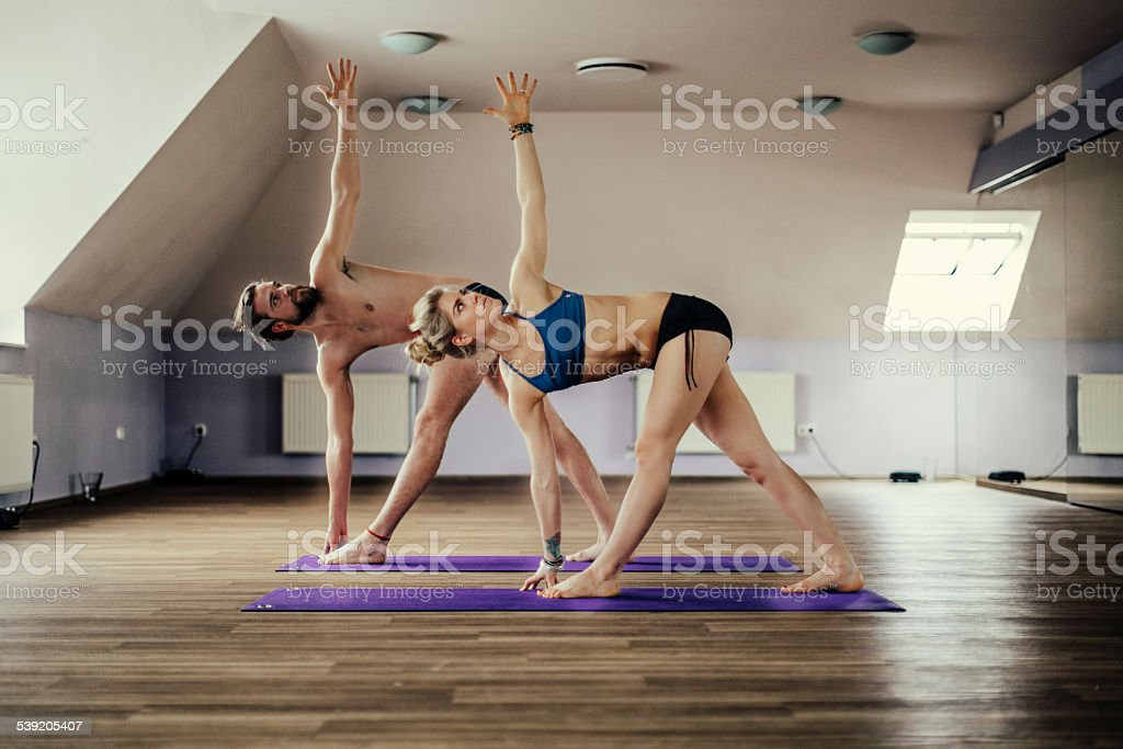 Young people exercising yoga royalty-free stock photo