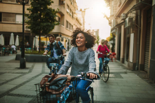 Young People Exploring The City On Bicycles stock photo