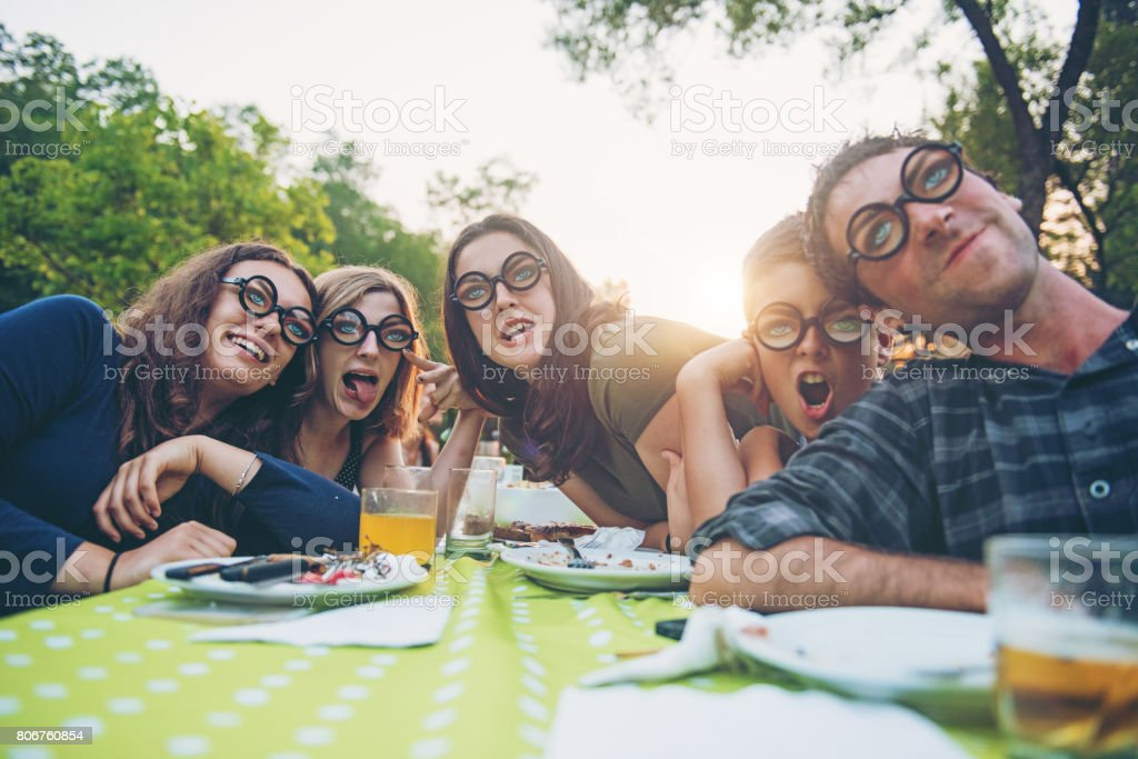 Young people fooling around during birthday party stock photo