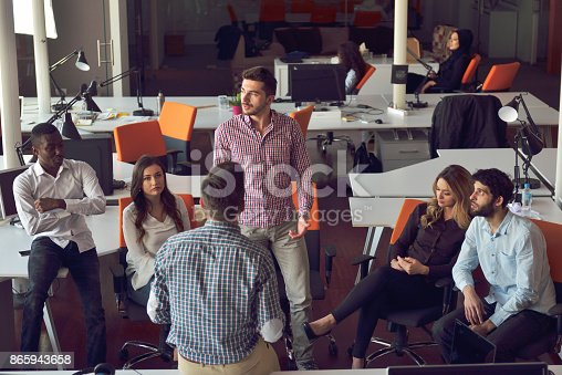 918746260istockphoto young people group in modern office have team meeting and brainstorming while working on laptop and drinking coffee 865943658