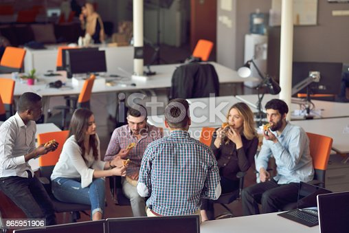 918746260istockphoto young people group in modern office have team meeting and brainstorming while working on laptop and drinking coffee 865951906