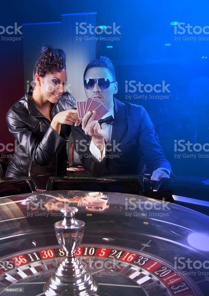 Young people have a good time in casino royalty-free stock photo