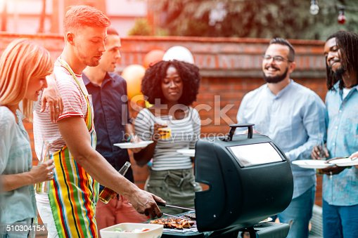 istock Young People Havin Fun At Barbecue Party. 510304154
