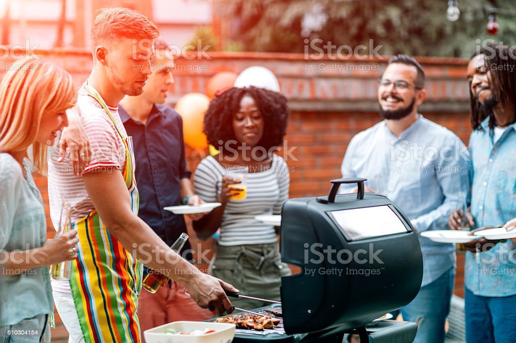 Young People Havin Fun At Barbecue Party. stock photo