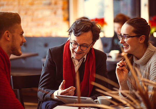 young people having a business meeting at the coffee bar - professor stock photos and pictures
