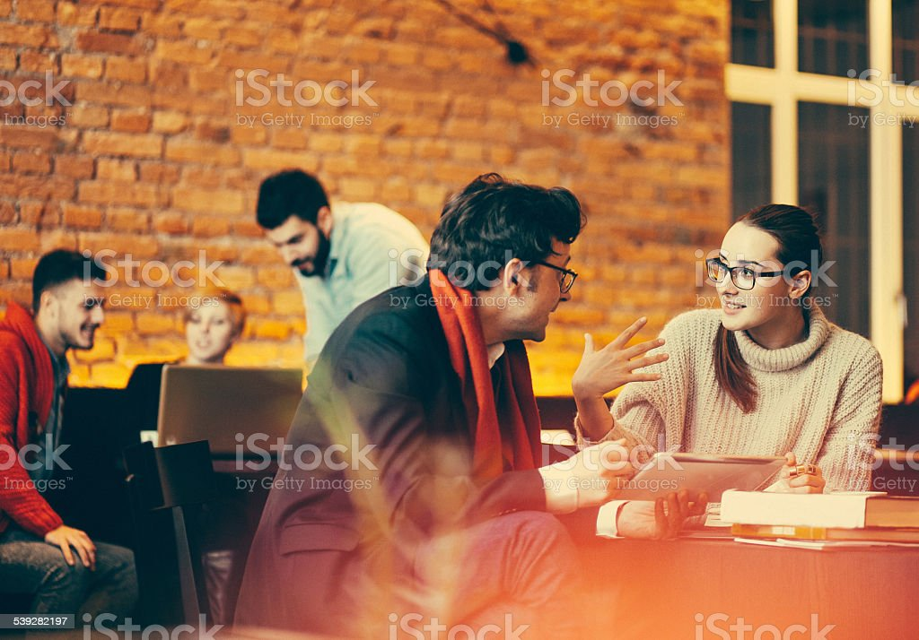 Young people having a meeting at the coffee bar stock photo