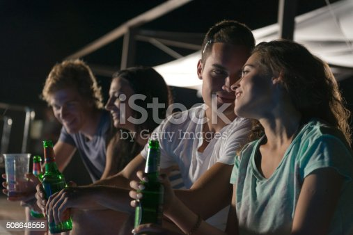 Four  young friends during summer vacations at night, Adriatic coast, Europe.