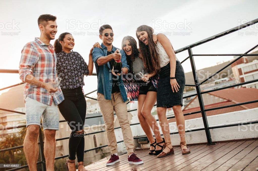 Young people having champagne at party. stock photo