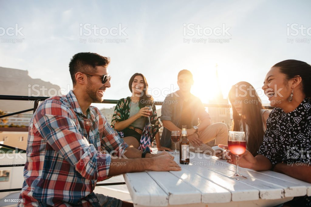 Young people having cocktail party stock photo