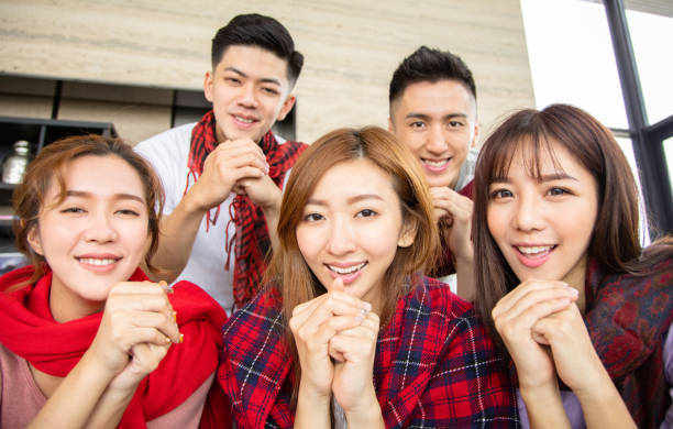 young people having fun and celebrating chinese new year - chinese new year stock pictures, royalty-free photos & images