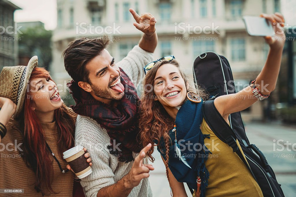 Young people having fun and making selfie stock photo