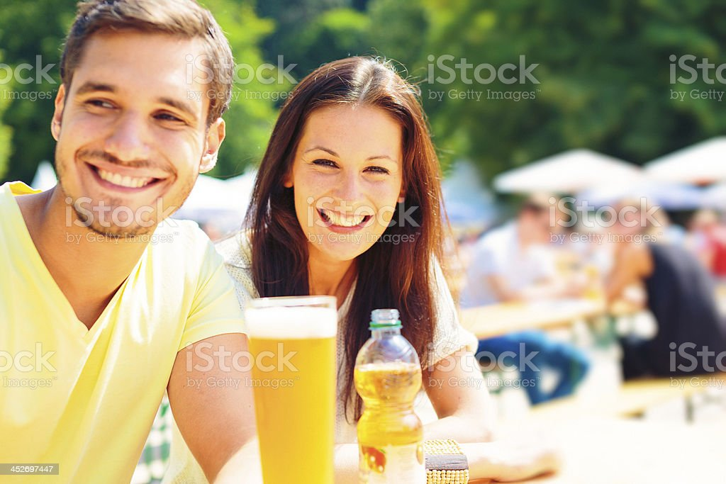 young people having fun at the beer garden stock photo