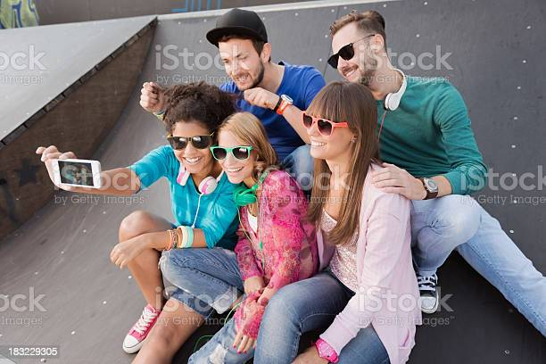 Young People Having Fun At The Skatepark Stock Photo - Download Image Now