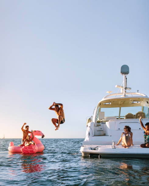 Young people having fun during party on a private boat - fotografia de stock