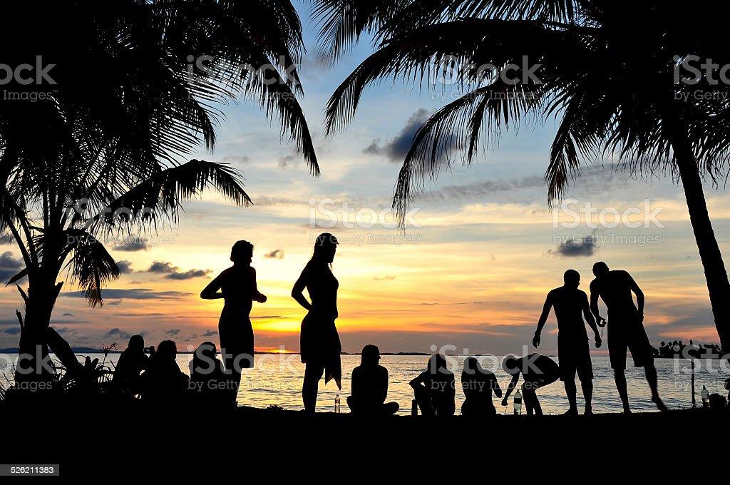 Young people having fun in the beach stock photo
