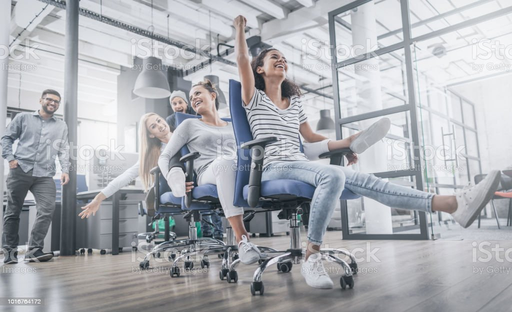 Young people having fun in the office. Happy team. foto stock royalty-free