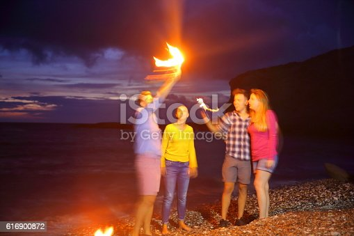 471113366istockphoto young people having fun on the beach 616900872