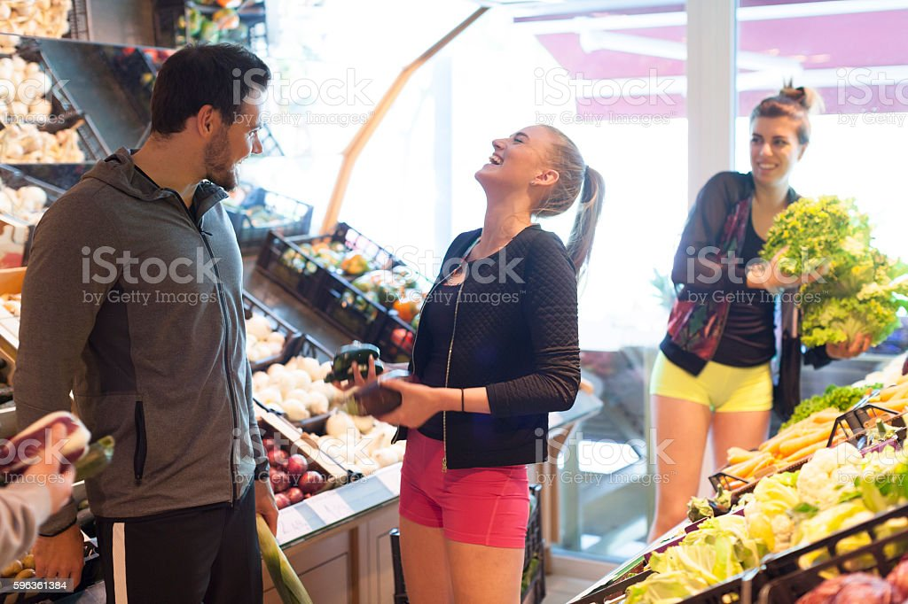 Young People Having Fun While Shopping in Fruit Vegetable Market royalty-free stock photo