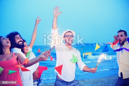 471113366istockphoto Young people having fun with fireworks and decoration hands up 508247644