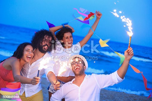 471113366istockphoto Young people having fun with fireworks and decoration 500845948
