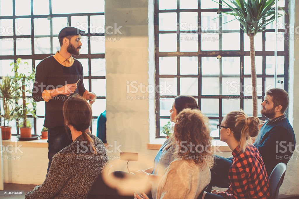 young people having meeting at the office stock photo