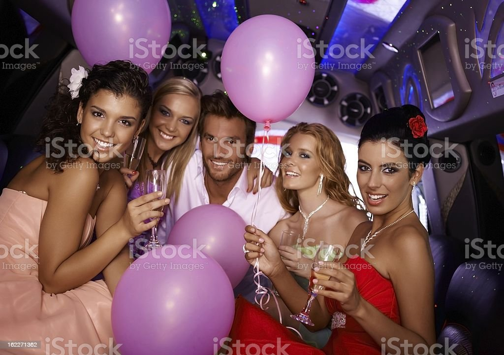 Young people having party in limo stock photo