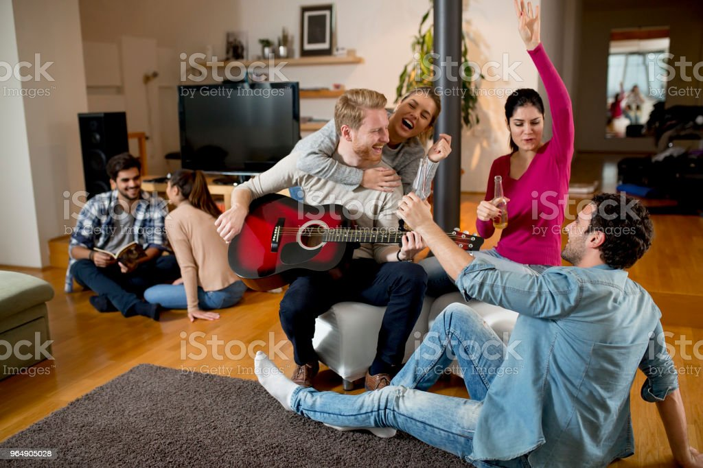 Young people having party with guitar royalty-free stock photo