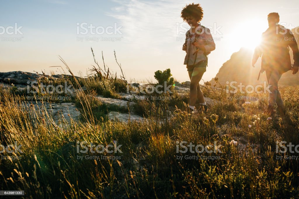 Young people hiking on a summer day stock photo