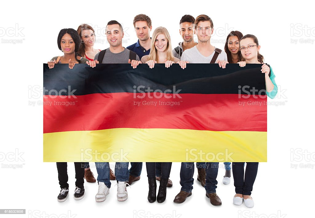 Young People Holding German Flag stock photo