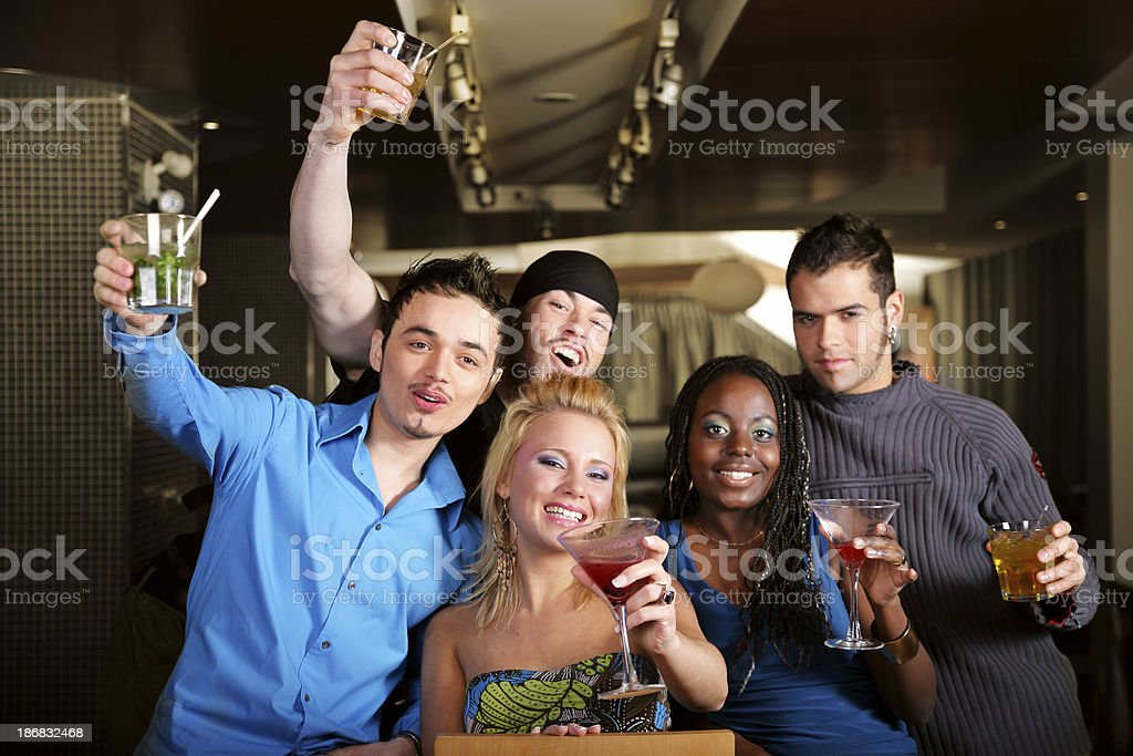 Young people in a bar royalty-free stock photo